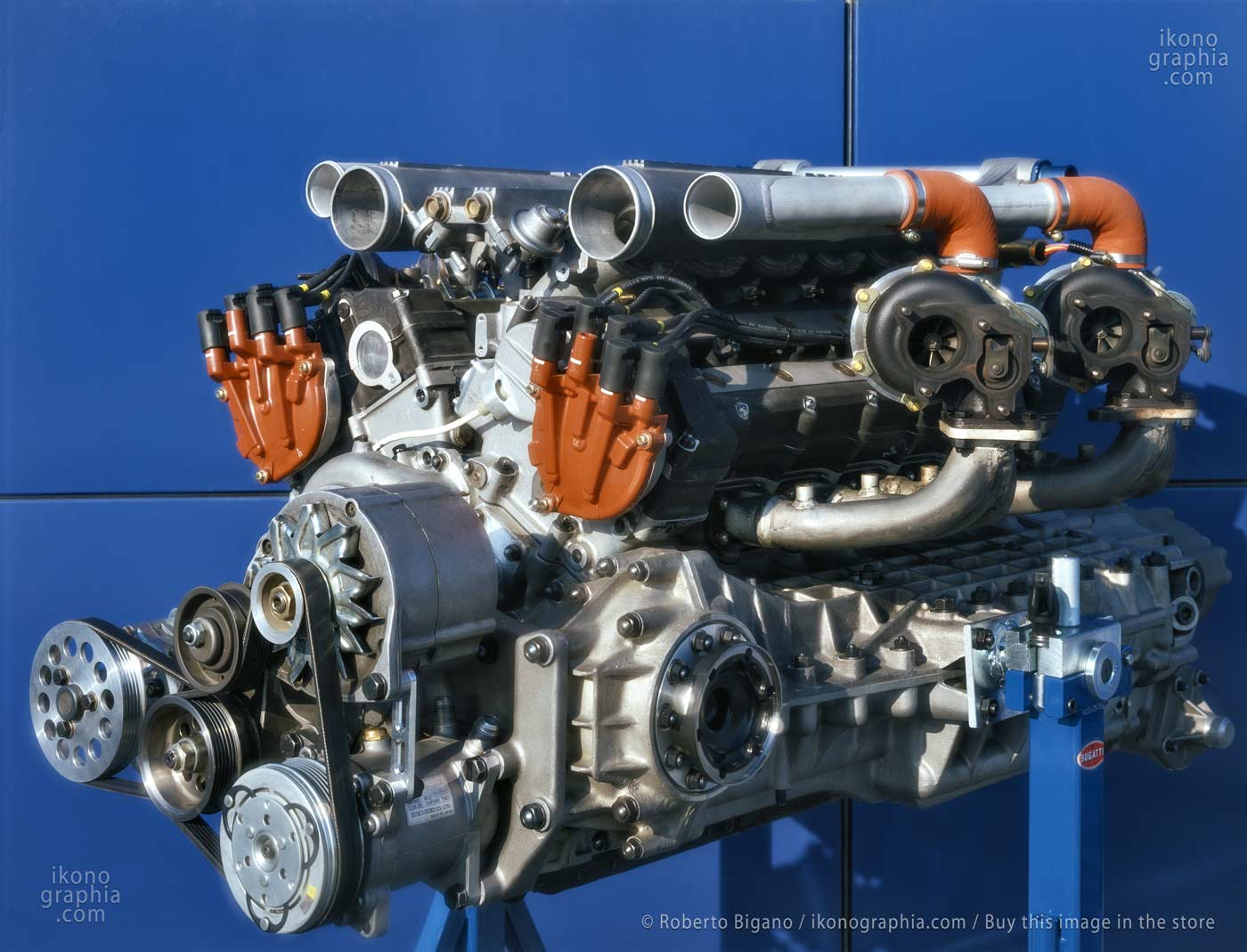 The Bugatti EB110 engine. A 3.5 L Bugatti quad-turbocharged V12. With five valves per cylinder, the 12-cylinder aluminum and magnesium engine block was designed in a single piece containing the six-speed transmission and two differentials: a marvel that surprised all the major car engineering departments, manufacturers. Photo by Roberto Bigano. Buy this image in the ikonographia.com store.
