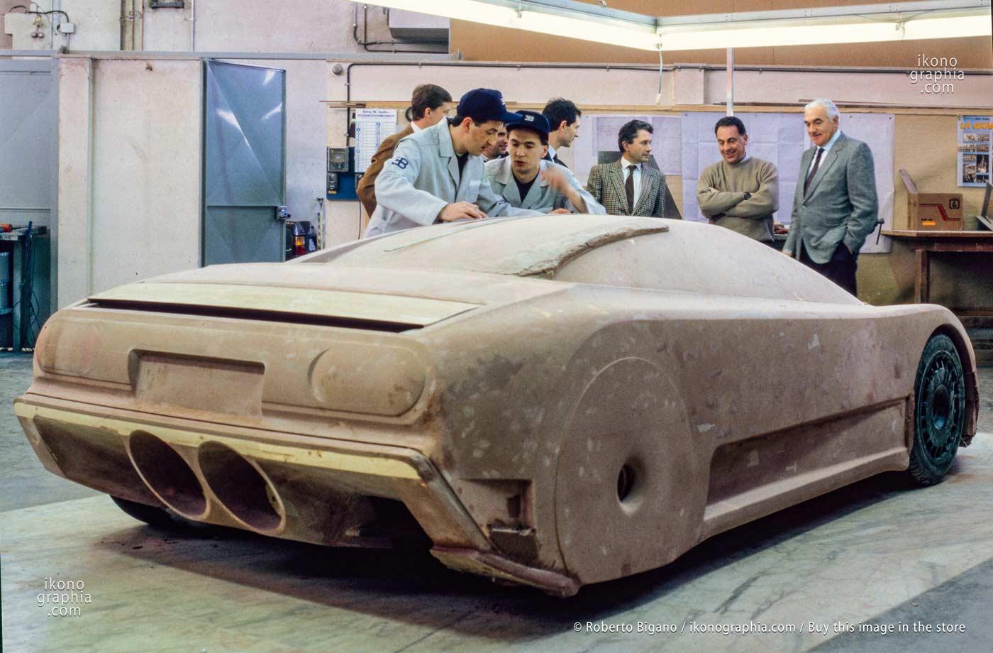 Marcello Gandini, Romano Artioli, and Gianpaolo Benedini heatedly discussing the design with the wooden model of the EB110. Photo by Roberto Bigano. Buy this image in the ikonographia.com store.