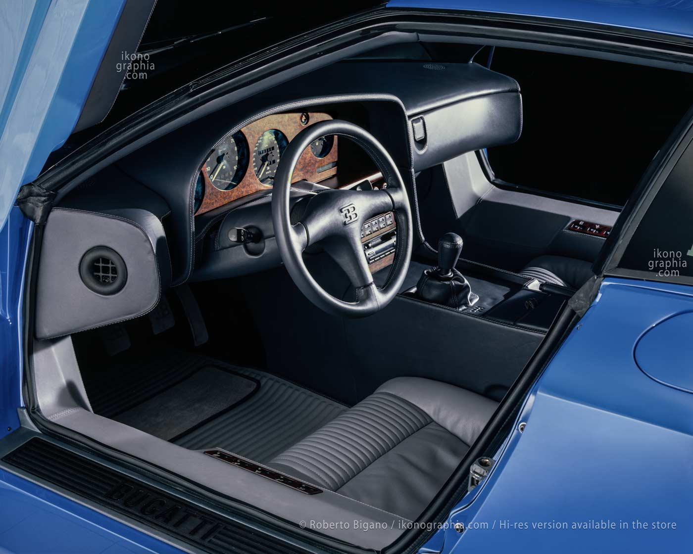 The interior of the Bugatti EB110. In the center of the steering wheel, the EB logo. Photo Roberto Bigano. Buy this image in the ikonographia.com store.